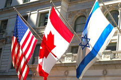 Amerikanische, kanadische, israelische Markierungsfahnen stockbild