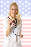 Amerikanische Krankenschwester mit Spritze Stockfotografie