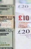 Amerikanische und britische Währung Stockbilder