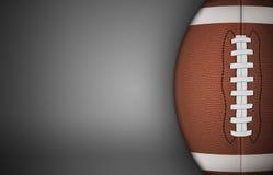 Amerikanischer Fußball-Ball auf Grau Stockbilder