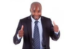 Amerikanischer Geschäftsmann des Schwarzafrikaners, der Daumen - afrikanisches p bildet Lizenzfreie Stockfotos