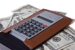 Amerikanisches Geld mit Notizblock und Rechner stockbild