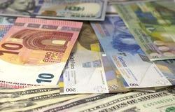 Amerikansk dollar, euro och schweizisk franc för pengarbakgrund arkivfoton