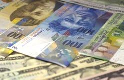 Amerikansk dollar, euro och schweizisk franc för pengarbakgrund Fotografering för Bildbyråer