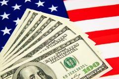 Amerikansk dollar och flagga Royaltyfri Foto
