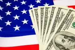 Amerikansk dollar och flagga Royaltyfria Bilder