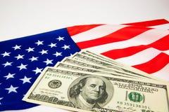 Amerikansk dollar och flagga Royaltyfria Foton