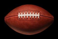 Amerikansk fotboll i djup skugga Royaltyfria Bilder