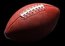Amerikansk fotboll i djup skugga Arkivfoton