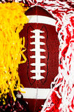 Amerikansk fotboll och Pom Poms Royaltyfri Bild