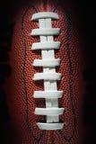 Amerikansk fotboll snör åt och textur Fotografering för Bildbyråer