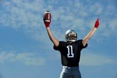 Amerikansk fotbollsspelare Celebrates som är nummer ett Royaltyfri Foto