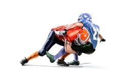 Amerikansk fotbollsspelare i handling på stadion Fotografering för Bildbyråer