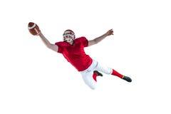 Amerikansk fotbollsspelare som gör poäng en landningsögonblick Arkivfoton