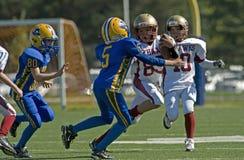 amerikansk fotbollungdom Fotografering för Bildbyråer