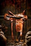 Amerikansk västra legendrodeocowboy Western Saddle arkivbild