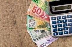 Amerikanska dollar, europeiskt euro, schweizisk franc, kanadensisk dollar, australisk dollar royaltyfri bild