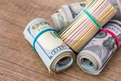 Amerikanska dollar i rullar Fotografering för Bildbyråer