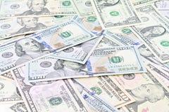 Amerikanska dollar kontanta pengar på vit bakgrund Royaltyfri Bild