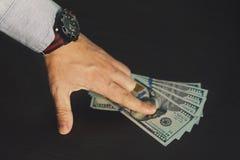 amerikanska dollar Muta och korrumperat begrepp Fotografering för Bildbyråer
