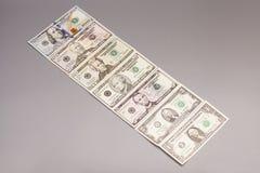 Amerikanska dollarräkningar för pengar Fotografering för Bildbyråer