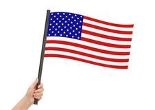 Amerikanska flaggan i hand Arkivbilder