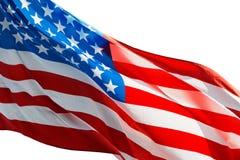 Amerikanska flaggan i vinden på vit bakgrund Royaltyfria Bilder