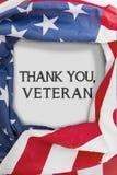 Amerikanska flaggan med symboliskt för dag för veteran` s Arkivfoton