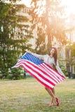 Amerikanska flaggan och kvinna (4th juli) Royaltyfria Bilder