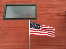 Amerikanska flaggan- och metallvägg Arkivfoton
