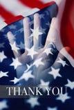 Amerikanska flaggan och text tackar dig royaltyfri bild