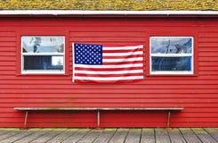 Amerikanska flaggan på väggen Arkivfoto