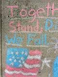 Amerikanska flaggan tillsammans står vi, delat oss faller Fotografering för Bildbyråer