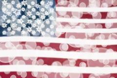 Amerikanska flagganBokeh ljus Fotografering för Bildbyråer