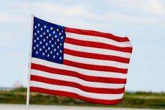 amerikanska flagganflygwind Arkivbilder