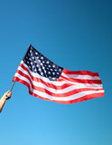 amerikanska flagganhandholding Royaltyfria Bilder