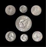 Amerikanska mynt på isolerad svart bakgrund Arkivbild