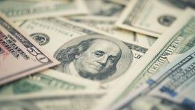 Amerikanska pengar för Closeup hundra dollarräkning Benjamin Franklin stående, oss makro för 100 dollar sedelfragment Arkivfoto