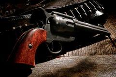 Amerikanskt västra revolvervapen och västra kula Klocka Royaltyfria Foton