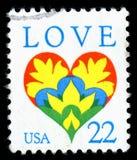 Amerikas förenta stater avbröt portostämpeln som visar en bild av en förälskelsehjärta Arkivfoton