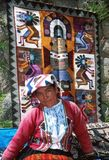 Amerindian woman. In traditional dress and the traditional Andean textile at the market, Perù. Andean textiles represent a continuing textile tradition Stock Image