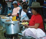 Amerindian women. Peru, Cuzco: Amerindian woman is cooking the food at the market. Amerindians constitute around 45% of the total population. The two major Royalty Free Stock Photos