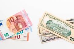 Amerykańscy Dolarowi i Euro banknoty odizolowywający na białym tle zdjęcia royalty free