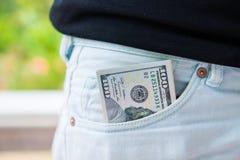 Amerykańscy dolary banknotu w kieszeni obrazy royalty free