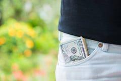 Amerykańscy dolary pieniądze w kieszeni obrazy stock