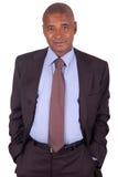 Amerykańska biznesowego mężczyzna pozycja na biel Zdjęcia Stock