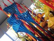 Amerykańska szklana rzeźbiarza i przedsiębiorcy Dale Chihuly ` s praca wystawiająca przy Clinton Prezydenckim centrum Obrazy Stock
