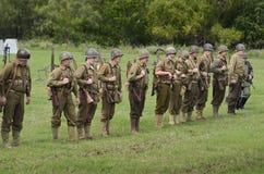 Amerykański oddział wojskowy w dziejowym reenactment WWII Obrazy Royalty Free