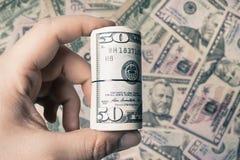 50 amerykan tła dolar tworząca tekstura i osoby mienia rolki moneta w ręce obrazy royalty free