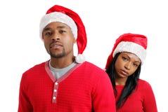 amerykanin afrykańskiego pochodzenia boże narodzenia dobierają się kapelusze Santa Obraz Royalty Free